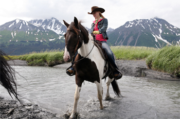 Darley Newman rides a horse named Orca outside of Seward, Alaska. All photos courtesy of Equitrekking.com
