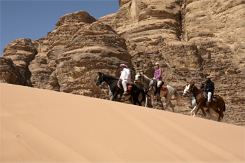 Riding Arabian horses with the Bedouin in the Wadi Rum Desert.