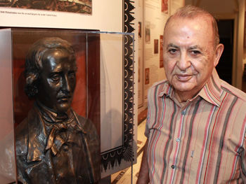 The author with a bust of Edgar Allan Poe at the Poe's historic home in Philadelphia. Photos by Habeed Salloum.