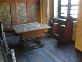 Luther's work table at his home in Wittenburg. His wife Katarina like to sit by the window and sew.