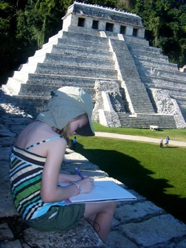 Loulou drawing the Temple of Inscriptions in Mexico.