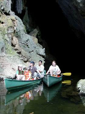 Canoeing through caves in Belize.