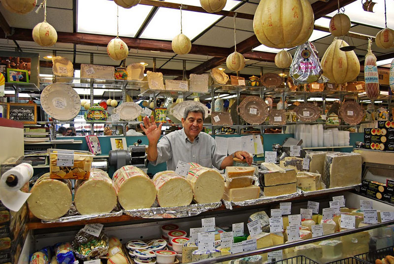 Tony with his collection of cheese at Tony's Colonial Food Store on Federal Hill in Providence, Rhode Island