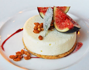 Goat Cheese Cake at Gracie's in Providence, Rhode Island - black Mission figs, sage cornmeal crust, port sauce and candied pine nuts
