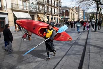Kayaker on the streets of San Sebastian, Spain. photo: Paul Shoul.