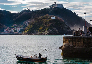 Fisherman heading out to sea in San Sebastian, Spain.