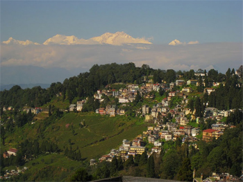 Darjeeling, overshadowed by the massive Himalayan Mountains behind it.