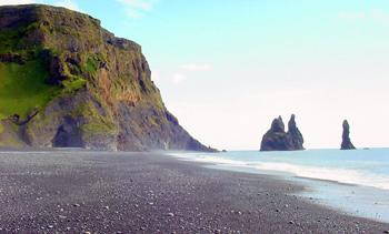 Black lava beaches, caves, and stacks of basalt columns around Vik.