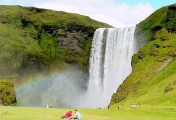 Skogafoss, which tumbles 200 feet over a rocky scarp creates a continual mist. A hiking trail brings you to the top.