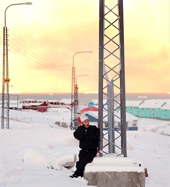 Boy on a cellphone in Ilulissat.