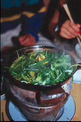 Braised fish sauteed with fresh herbs at Cha Ca La Vong Restaurant.