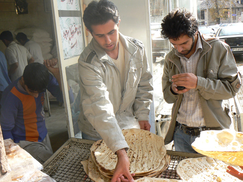 Bread vendor in Tehran. Bread like this is cooked on the sides of a hot oven and costs about 60 cents a loaf.