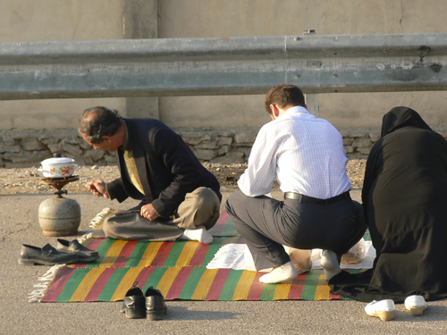 Picnicking is an Iranian tradition...here a family sets out their food right next to a highway toll plaza outside of Tehran.