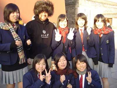 Peking University students offer us the peace symbol.