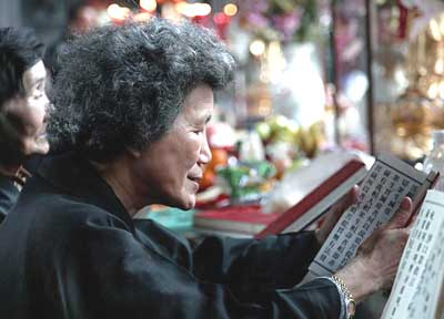 A woman reading at the Lungshan Temple