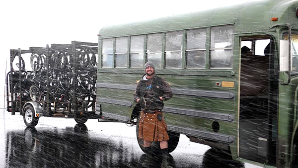 Doug Bailey of Beartooth Bike Tours, at the state line between Montana and Wyoming during an August snowfall.