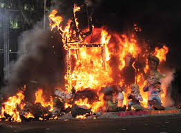 Las Fallas translates in English to 'The Fires'.