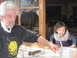 Rafael, the 'Paella King,' and his assistant Manuel at La Matandeta Restaurant in rural Alfafar.