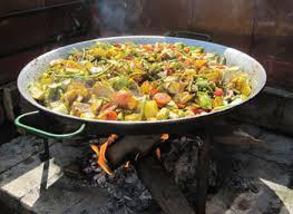 Paella cooks over an open flame at La Matandeta Restaurant.