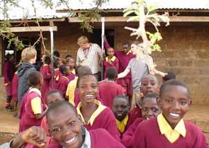 Mark Jenner (center) visits a school in Kenya.