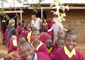 Mark Jenner (center) visits a school in Kenya.