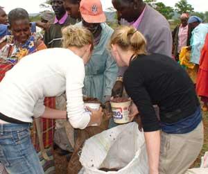 Volunteers distribute food.