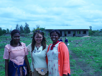 With Naomi and Norah in front of Bomani Primary School