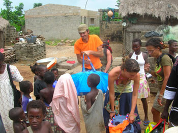 Brandon McKay and Stefny Poillot giving out clothes to the people of Asaafa, Ghana