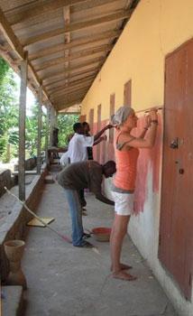Volunteers painting the school in Assafa, Ghana