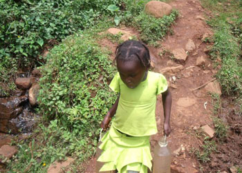 A little girl preparing to carry water three kilometers back home.