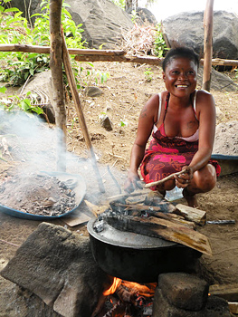 Omo, who works in the Tribewanted kitchens, makes banana bread by the fire. Photo by Tom Volpe.