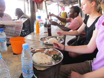 After meeting entrepreneurs, investourists enjoy a traditional lunch in Tanzania.