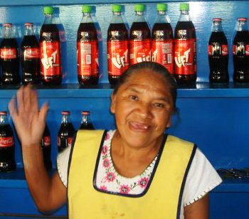 A micro-entrepreneur from Puerto Vallarta waves a greeting.