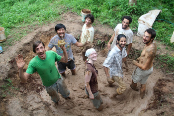Mixing mud for adobe bricks at the Panya Project in Thailand.