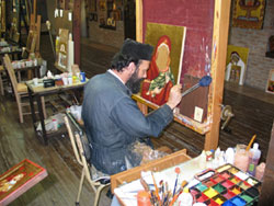 Monk paints icons.