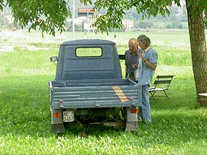 Mom and Dad check out the local vehicles in Le Marche, Italy. photo by Max Hartshorne