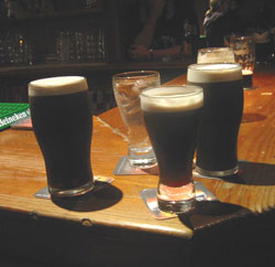 Learning to pour a pint of Guiness is part of the experience.