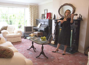 Theresa Bourke practices in her sitting room, where the lessons take place.