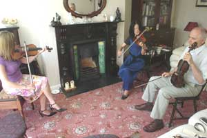 Theresa Bourke of the Fiddlers' Retreat teaches students in her living room. Photos courtesy of FiddlersRetreat.com