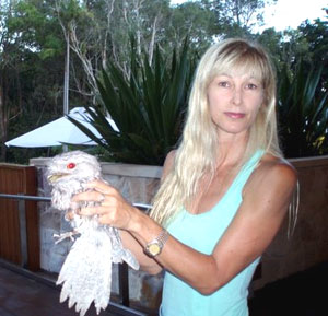 A Byron Bay game warden with an injured bird