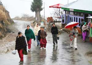 The canteen at Sojha and people walking home in rain