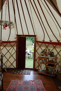 The comfortable inside of a yurt on the Isle of Wight.