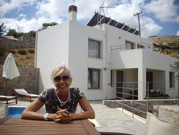 The author in front of one of the four guest villas at the Mourtzanakis Residence