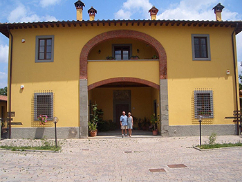A home exchanging couple at their rented house in Tuscany.