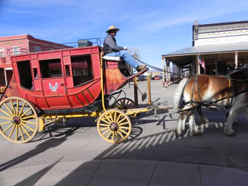 Stagecoaches clip-clop along Allen Street in Tombstone.