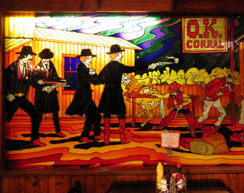 The Earp brothers fire away in a stained glass window at a Tombstone restaurant.