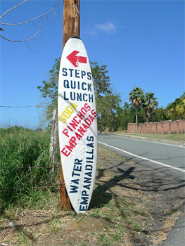Sign tells surfers where to eat in Rincon, Puerto Rico.