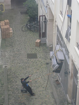 These piano movers were the first thing Stacey saw out her window in Paris.