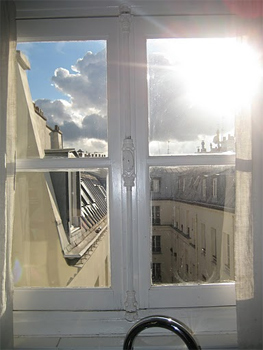 Looking out the window of the Paris apartment.