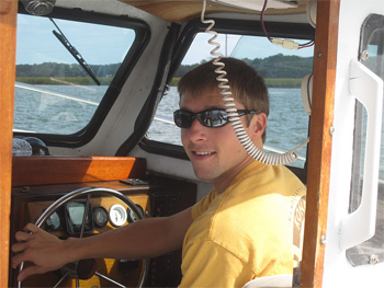 The author piloting the boat on the Darien River, Georgia.